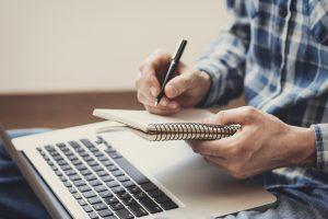 iStock-840602536-journalist-notebook-laptop-Large-300x200