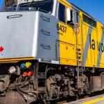 A VIA Rail Locomotive on the Railroad Tracks